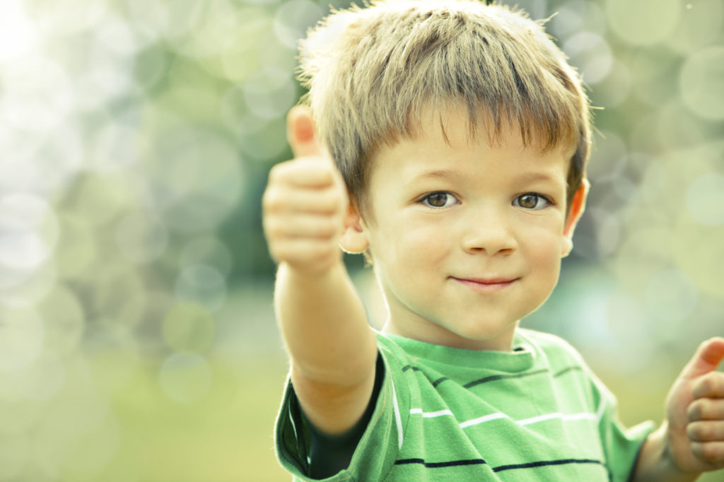 Happy kid giving thumbs up due to game changer tutoring